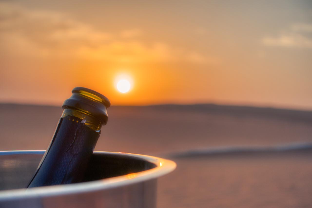 Dubai desert sparkling wine sunset